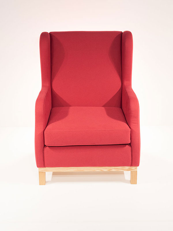 breez armchair red upholstered with oak leg frame