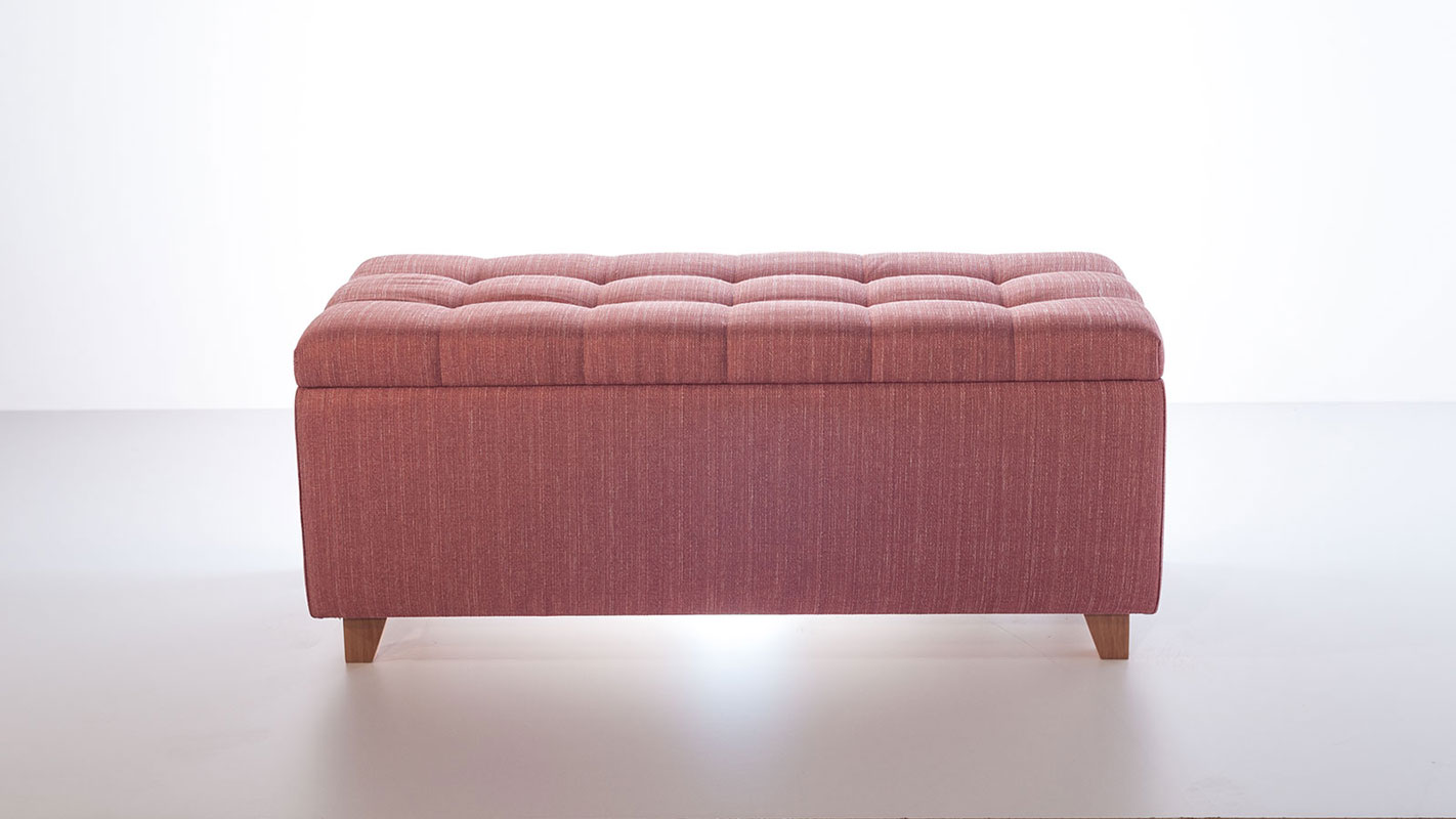 button pink upholstered ottoman