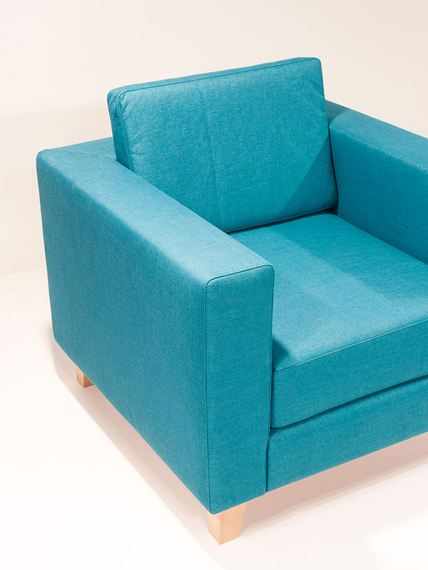 cubiq blue upholstered armchair with oak legs