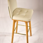 cupo barstool upholstered with eco-leather with oak frame and metallic details