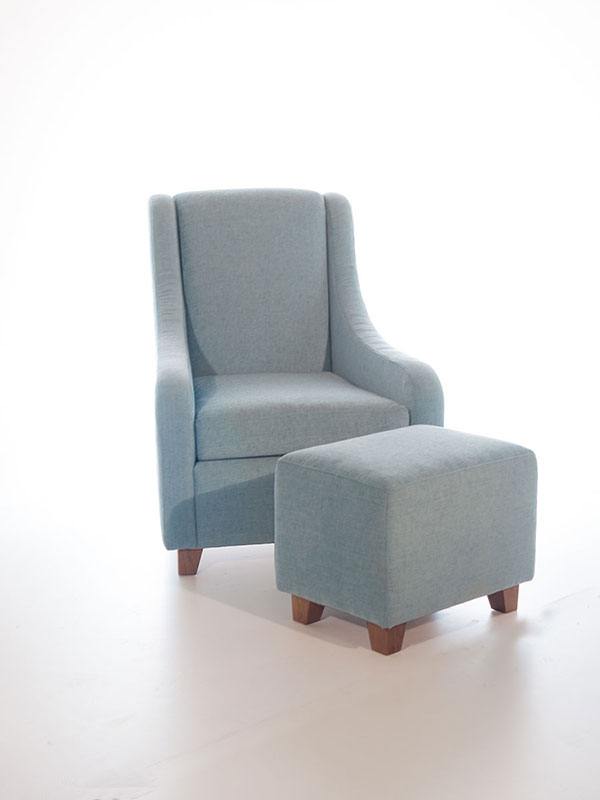 curve armchair and footstool blue upholstered with oak legs and