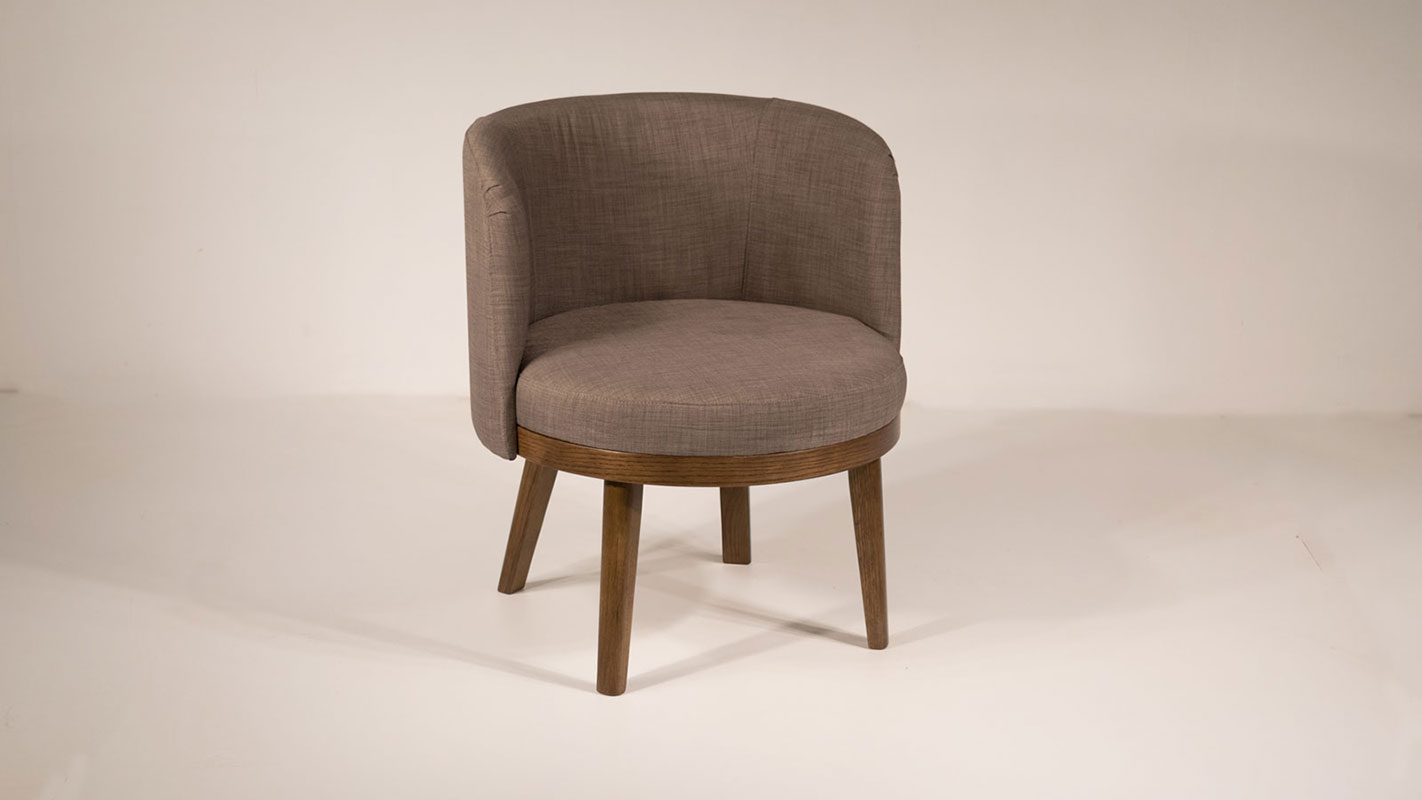 yasmin upholstered armchair with oak legs
