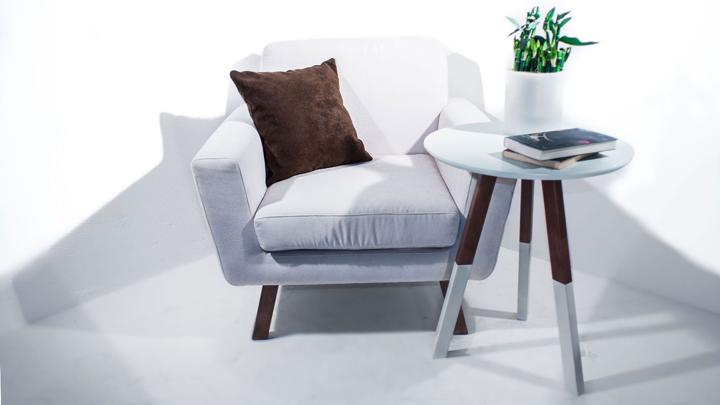 med armchair white upholstered with oak legs and circle rounded coffee table