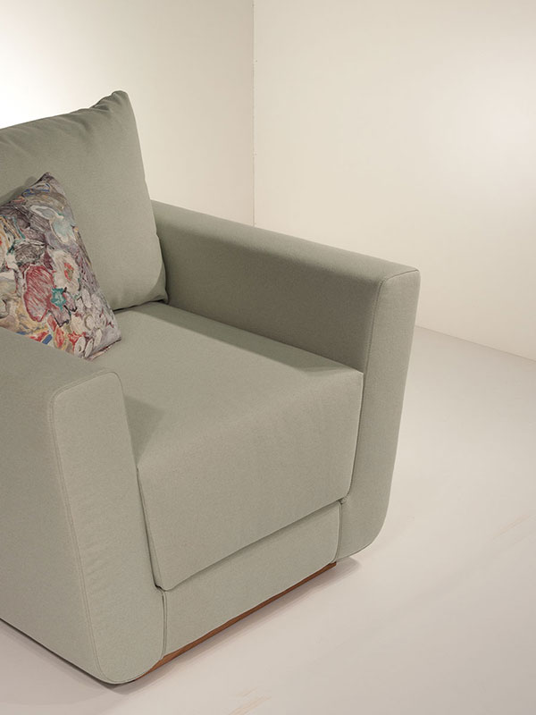 olive upholstered armchair